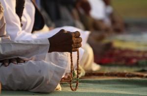 A man holds prayer beads as he attends Eid al-Fitr prayers in Benghazi